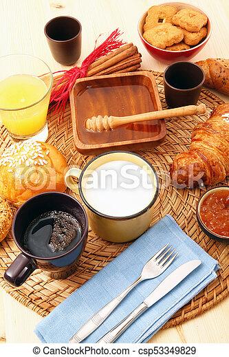 breakfast on rustic wooden table - csp53349829