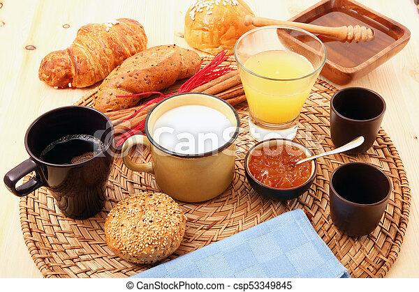 breakfast on rustic wooden table - csp53349845