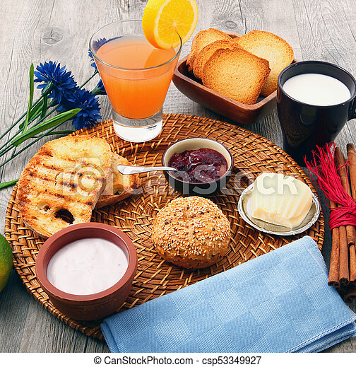 breakfast on rustic wooden table - csp53349927