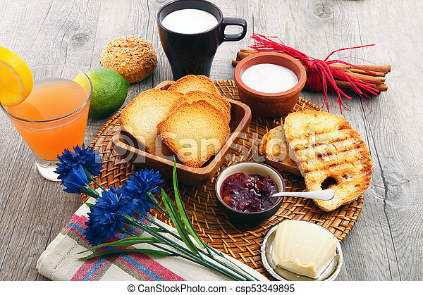 breakfast on rustic wooden table - csp53349895