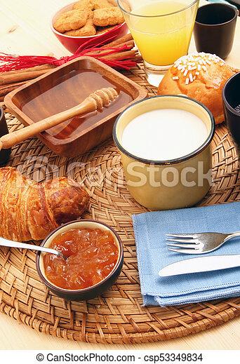 breakfast on rustic wooden table - csp53349834
