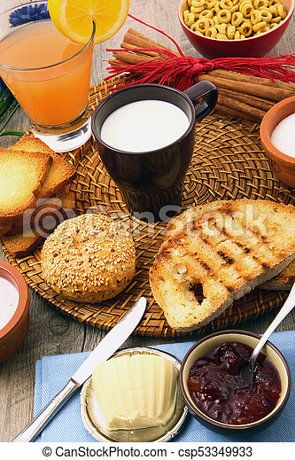 breakfast on rustic wooden table - csp53349933