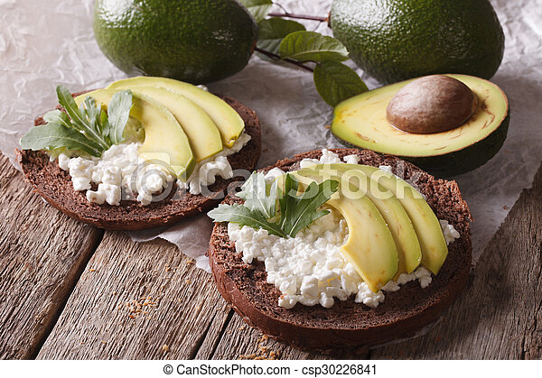 breakfast sandwiches with cream cheese and avocado close-up - csp30226841
