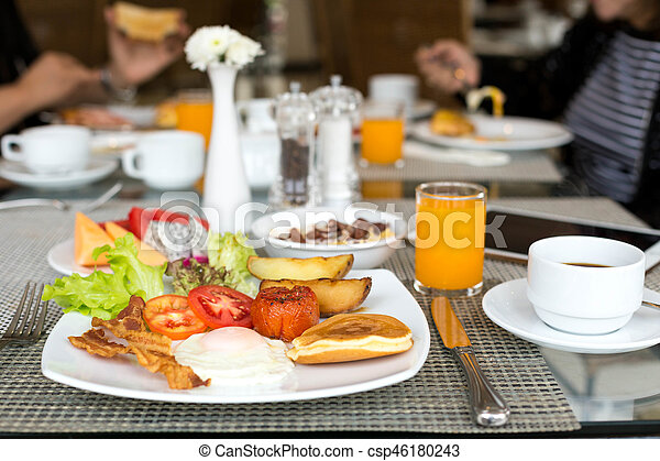 Breakfast set on the table with pancakes, bacon - csp46180243