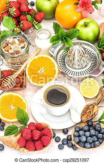Breakfast table setting with coffee, croissants, granola,... stock ...
