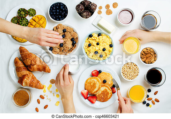 Breakfast table setting with flakes juice croissants pancakes and fresh berries - csp46603421 & Breakfast table setting with flakes juice croissants pancakes and ...