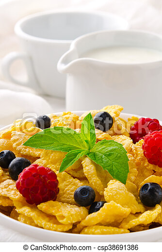 Breakfast with cereal flakes, berries, mint and milk - csp38691386