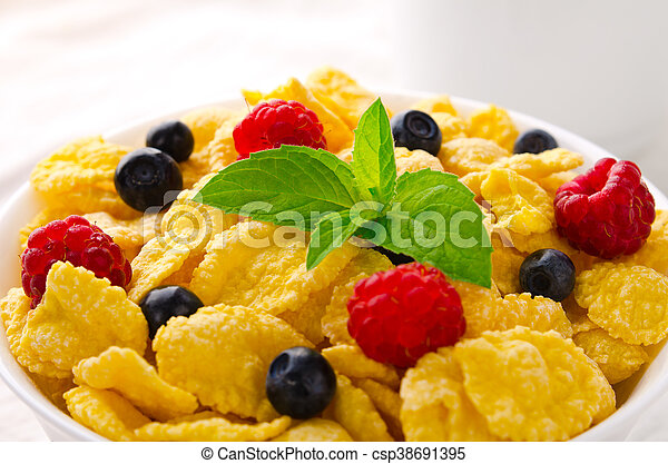 Breakfast with cereal flakes, berries, mint and milk - csp38691395