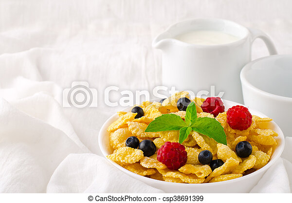 Breakfast with cereal flakes, berries, mint and milk - csp38691399