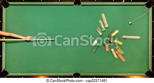 Breaking Pool Balls on green table - csp22371481