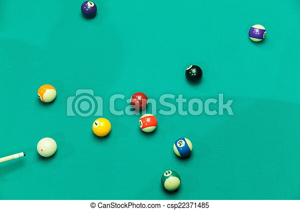 Breaking Pool Balls on green table - csp22371485