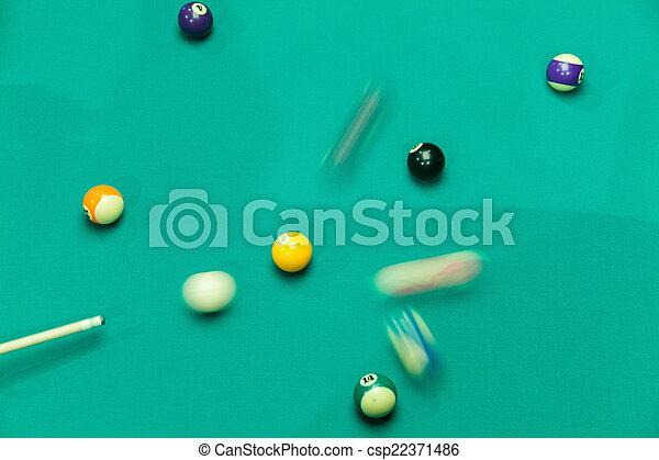 Breaking Pool Balls on green table - csp22371486