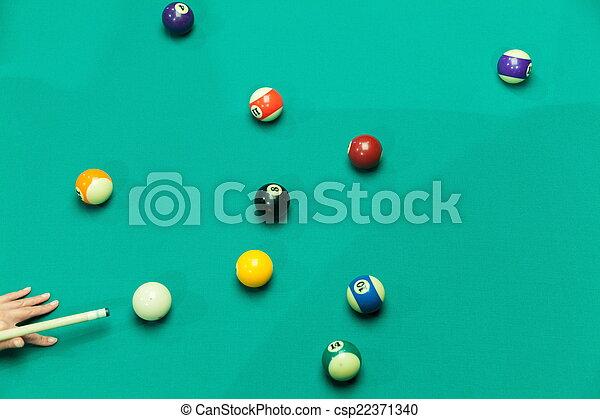 Breaking Pool Balls on green table - csp22371340