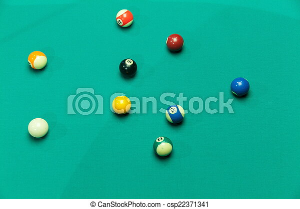 Breaking Pool Balls on green table - csp22371341