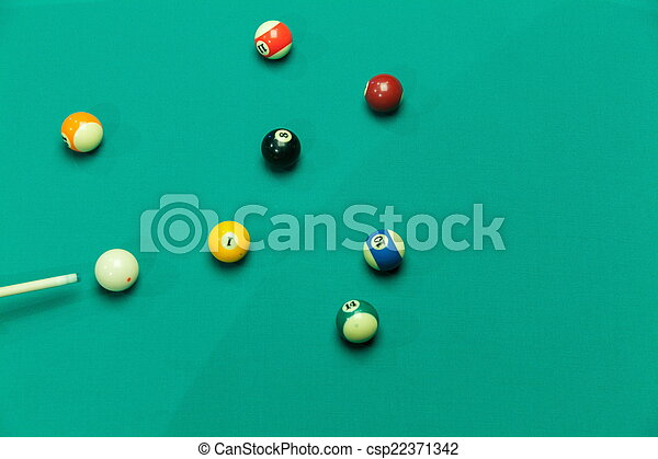 Breaking Pool Balls on green table - csp22371342