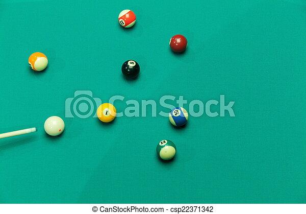 Breaking Pool Balls on green table - csp22371342