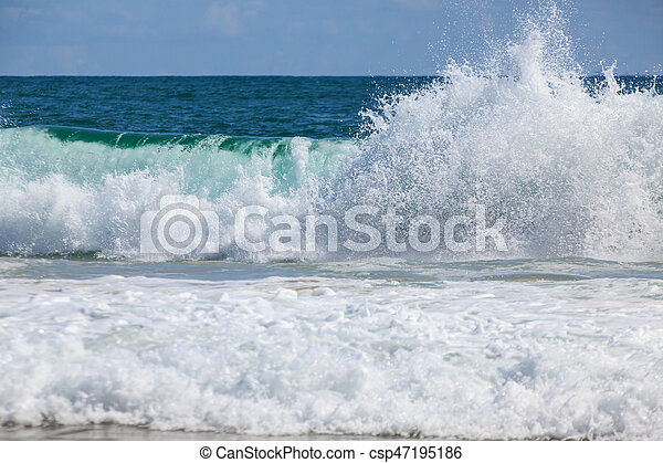 Breaking wave at the beach - csp47195186
