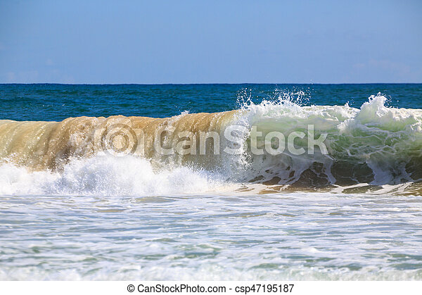 Breaking wave at the beach - csp47195187