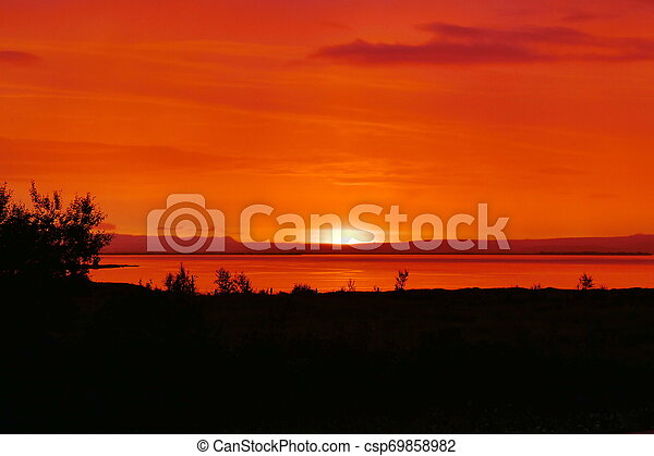 Breathtaking red sunset over Lake Myvatn in Northern Iceland - csp69858982