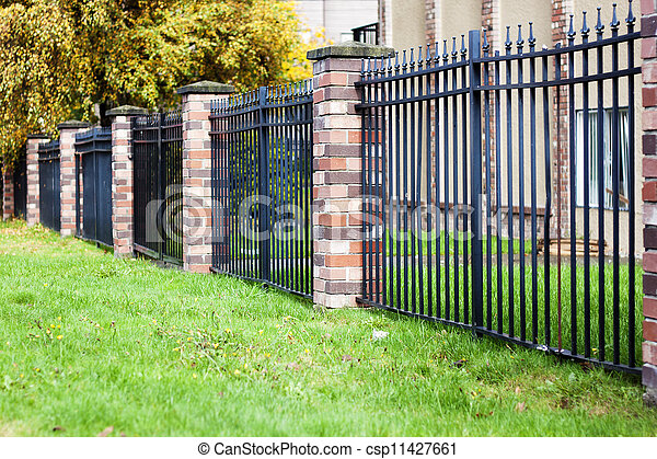 brick and metal fence in urban community - csp11427661