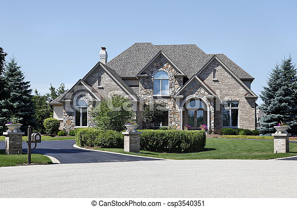 Brick and stone home with cedar roof - csp3540351