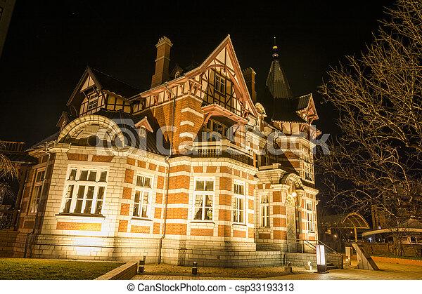 Brick building at night - csp33193313