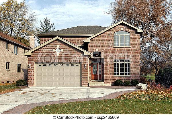 Brick home in fall - csp2465609