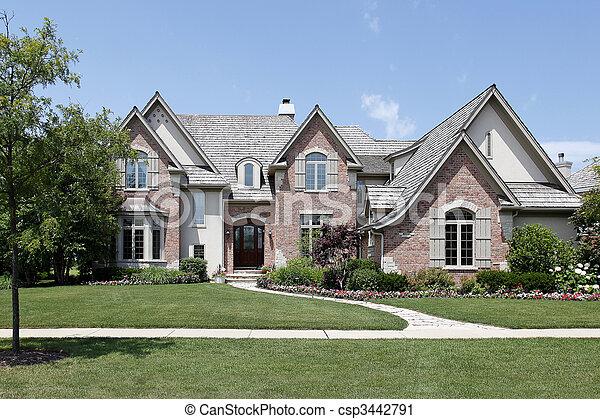Brick home with cedar roof - csp3442791