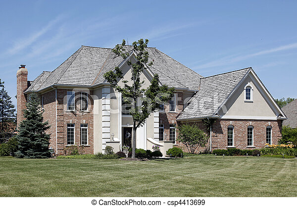 Brick home with cedar roof - csp4413699