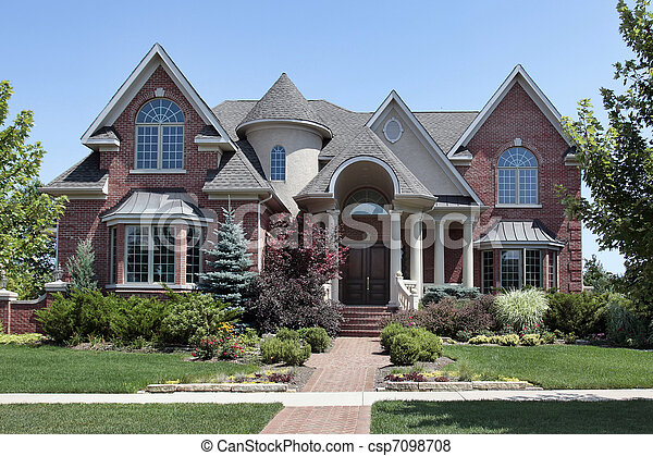 Brick home with turret - csp7098708