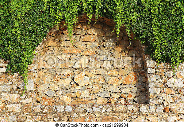 Brick wall and climbing plant. Detail of brick wall with decorative ...