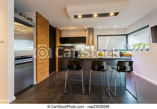 Brick wall in contemporary kitchen - csp23528286