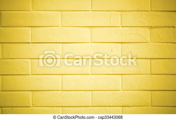 Texture of a brick wall painted with yellow paint stock image ...