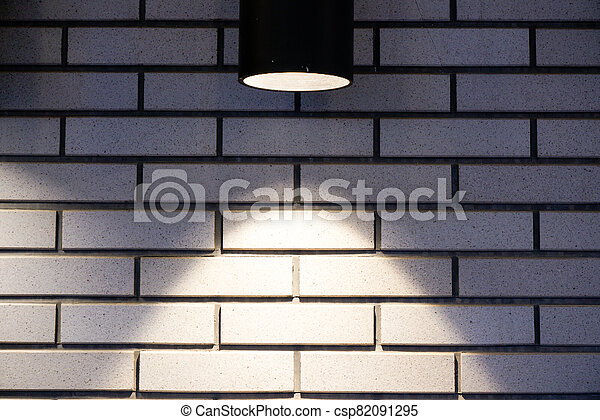 Brick wall with a lamp background - csp82091295