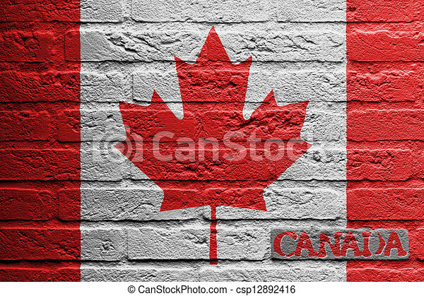 Brick wall with a painting of a flag - csp12892416