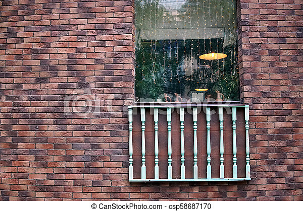 Brick wall with a window - csp58687170