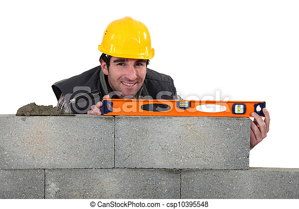 Bricklayer with a spirit level - csp10395548