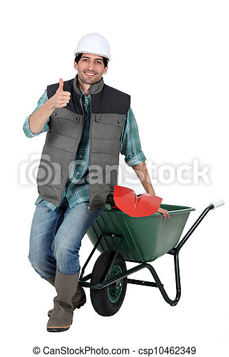 bricklayer with wheelbarrow and trowel thumb up - csp10462349