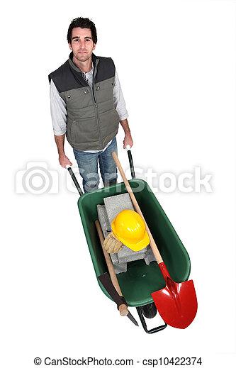 bricklayer with wheelbarrow - csp10422374