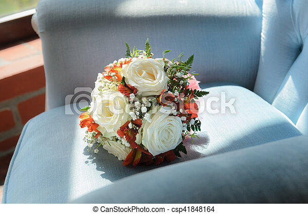 Bridal bouquet in soft antique chair - csp41848164