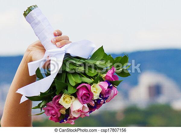 Bride and bouquet. Wedding Bouquet. Bouquet in the hands of the bride. Bride holding a wedding bouquet. - csp17807156