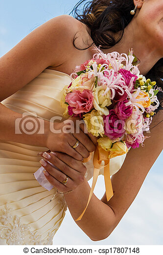 Bride and bouquet. Wedding Bouquet. Bouquet in the hands of the bride. Bride holding a wedding bouquet. - csp17807148