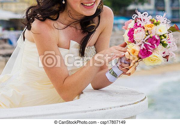Bride and bouquet. Wedding Bouquet. Bouquet in the hands of the bride. Bride holding a wedding bouquet. - csp17807149