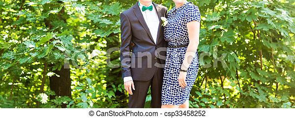 bride and bridesmaid outside happy hug - csp33458252