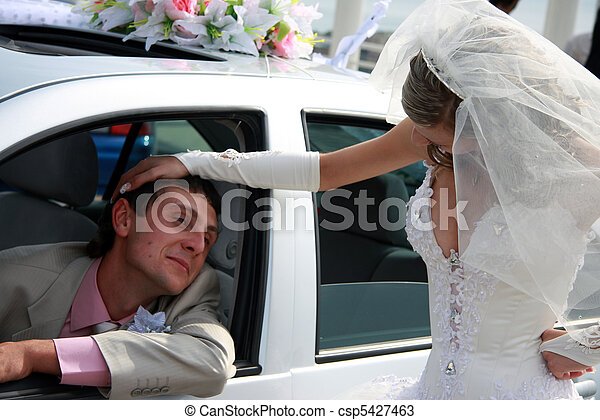 Bride and groom. Groom in the car - csp5427463