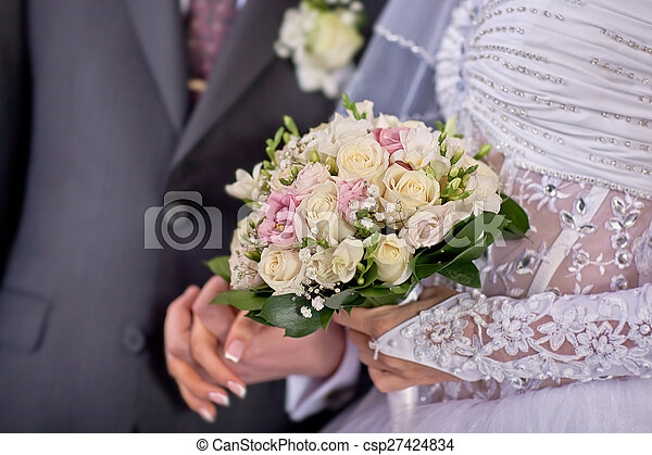 Bride and groom holding hands - csp27424834