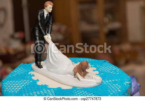 bride and groom on wedding cake - csp27747873
