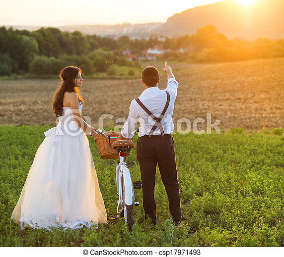 Bride and groom with a white wedding bike - csp17971493