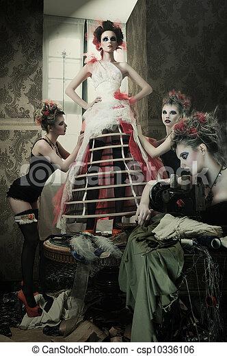 Bride at the clothes shop for wedding dresses - csp10336106