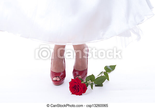 Bride feet in red shoes with rose - csp13260065